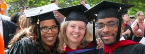 Image: Three smiling graduates at convocation