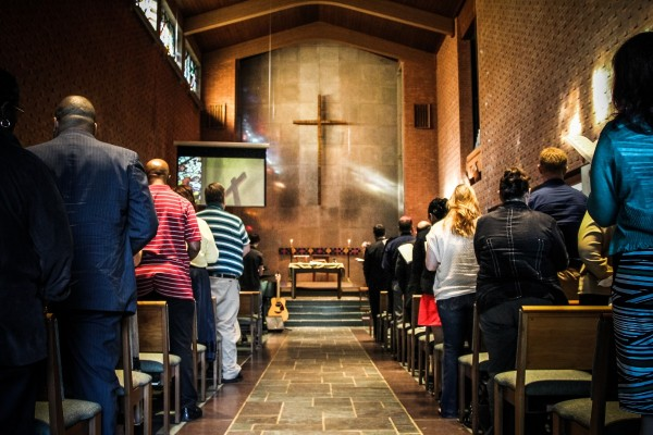 Image: people attending a chapel service, facing the altar table