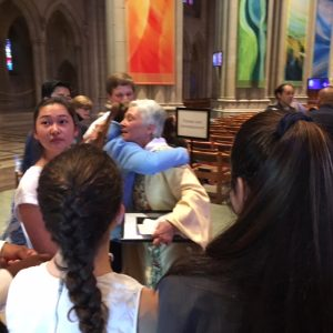 The Rev. Gina Campbell hugging young people at her farewell service at the Washington National Catherdral